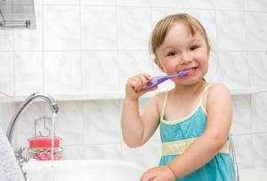 young-pediatric-dental-patient-pleased-that-her-childrens-dentist-office-in-bonita-springs-offers-white-composite-fillings-that-offer-many-benefiits-to-restore-her-teeth
